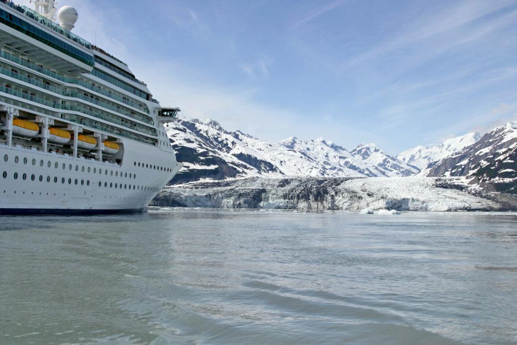 Hubbard Glacier, a beautiful Alaskan glacier, with a cruise ship in the foreground.