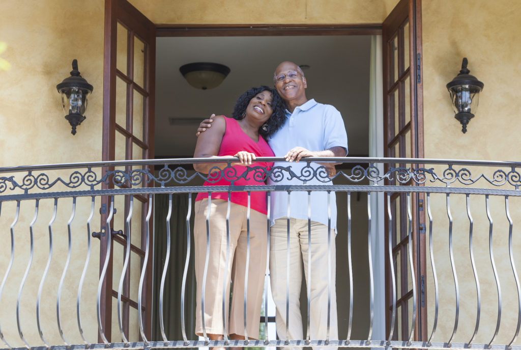 african american couple standing on hotel balcony during a date