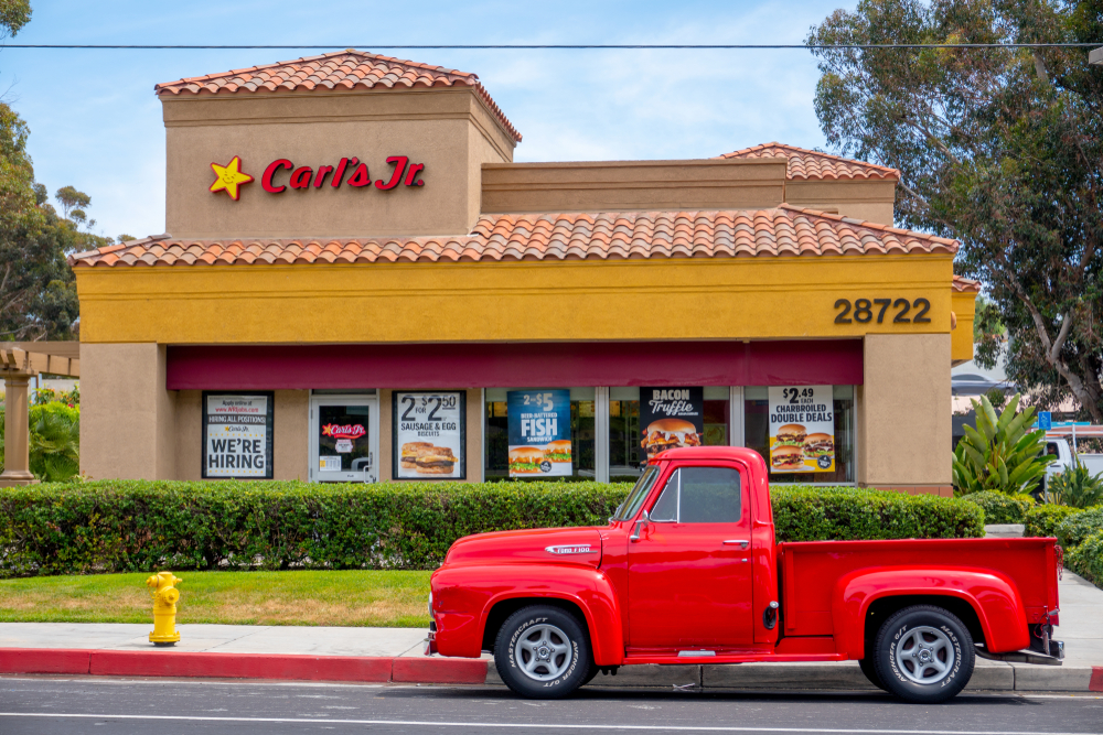 carl's jr. fast food resaurant with red ford truck parked out front