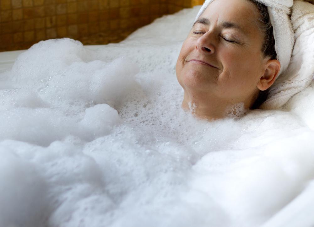 elderly woman relaxing in walk-in tub