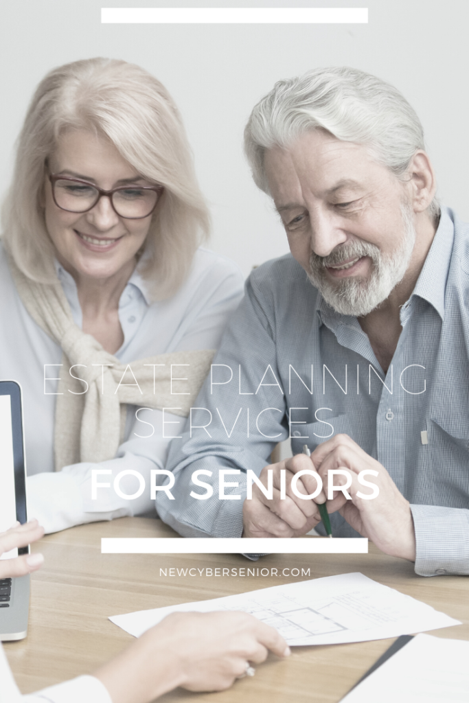 two seniors looking at financial information with an estate planner