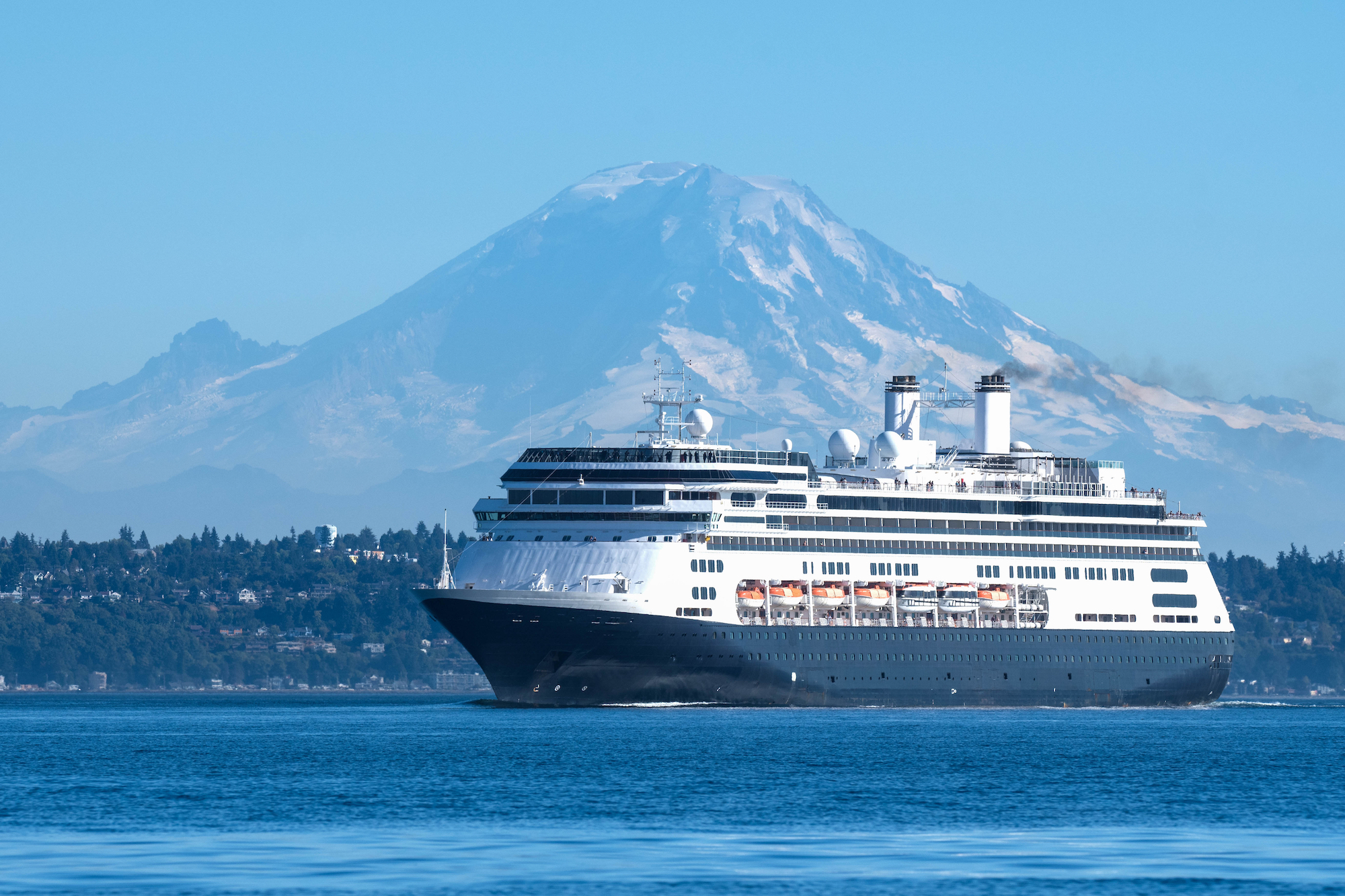 holland america cruise ship leaving seattle washington with mt. rainer in the background