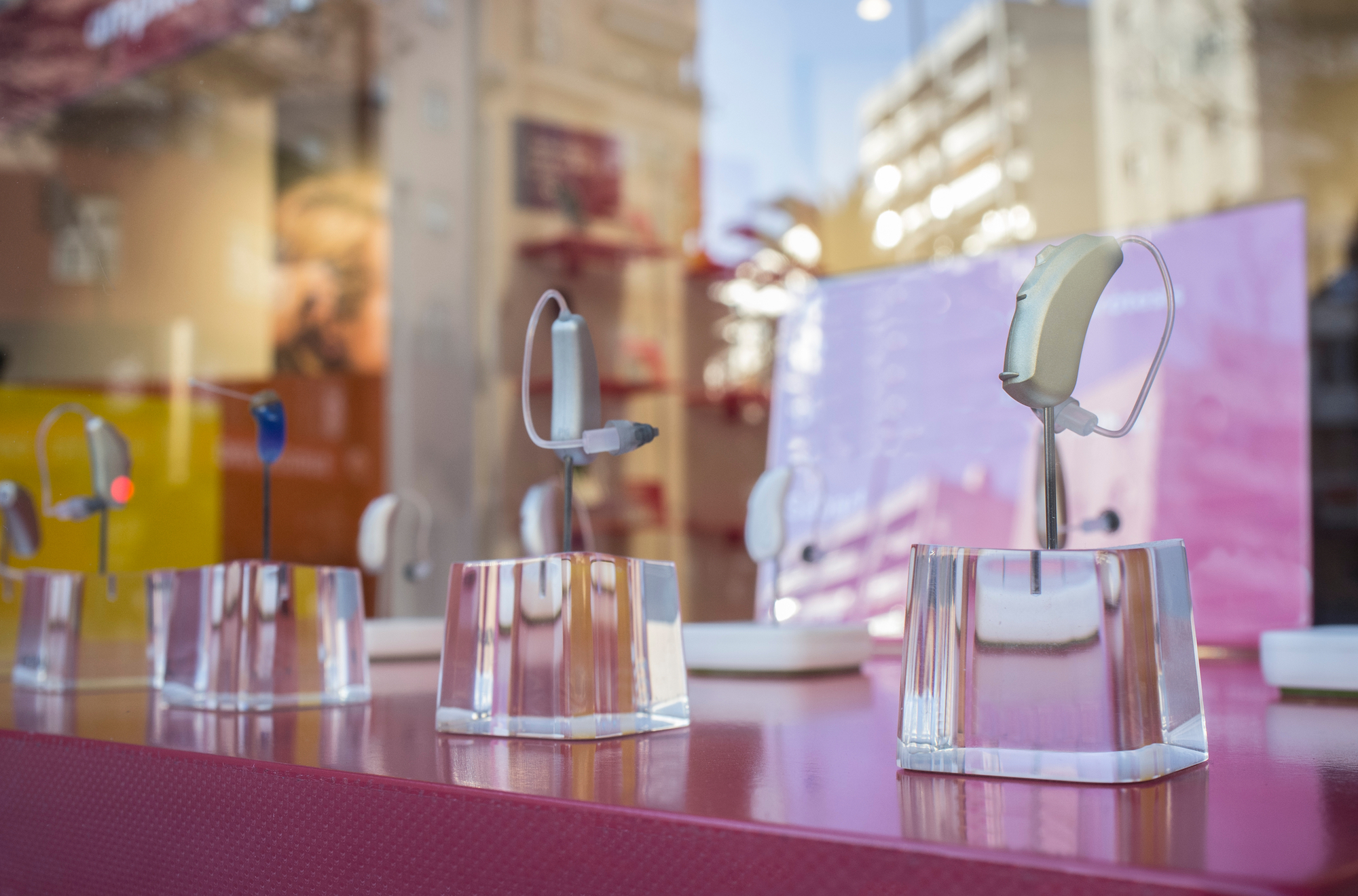 modern hearing aids in display cases