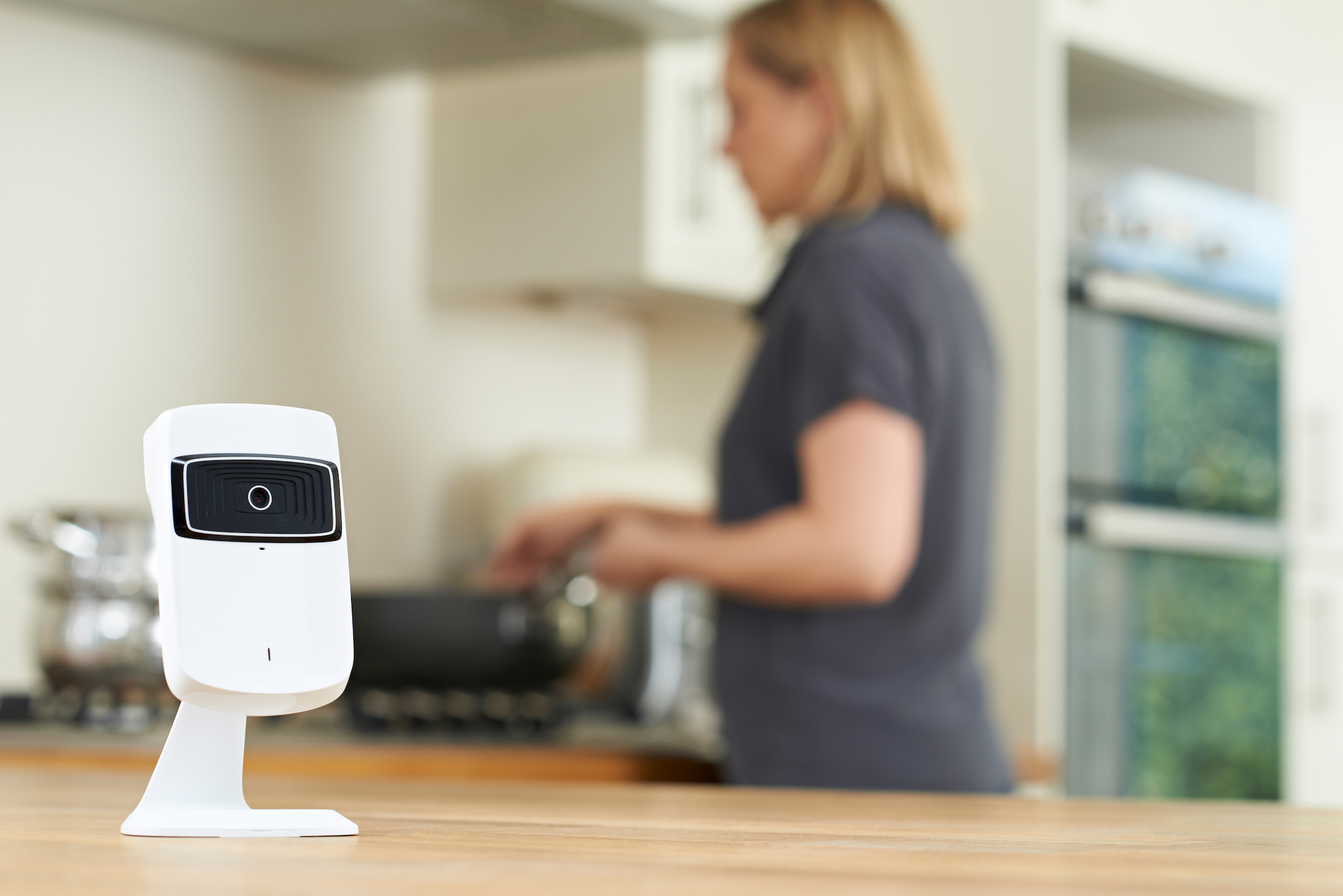 modern wireless security camera inside the kitchen
