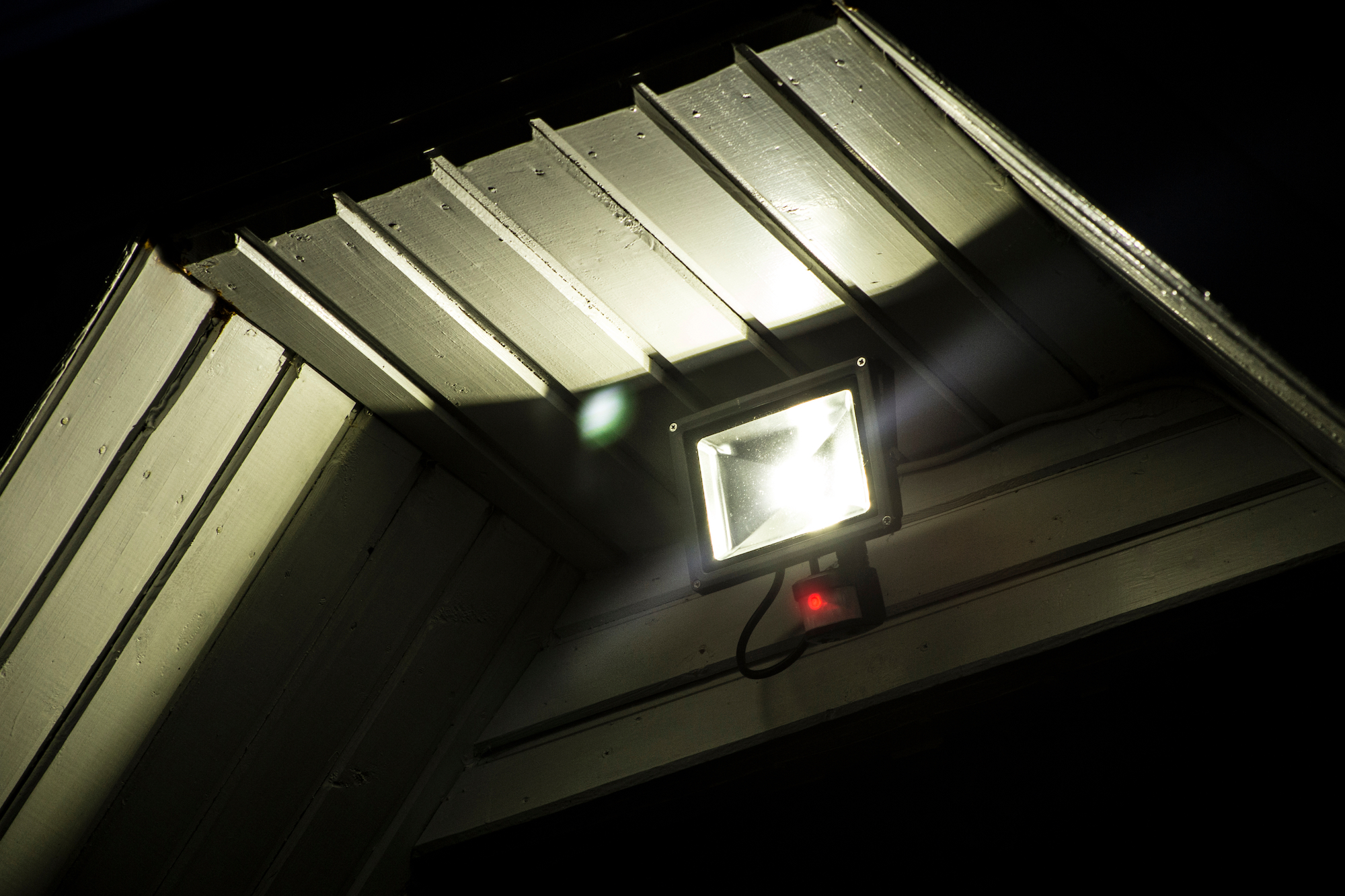motion sensor light under awning of house a night with floodlight
