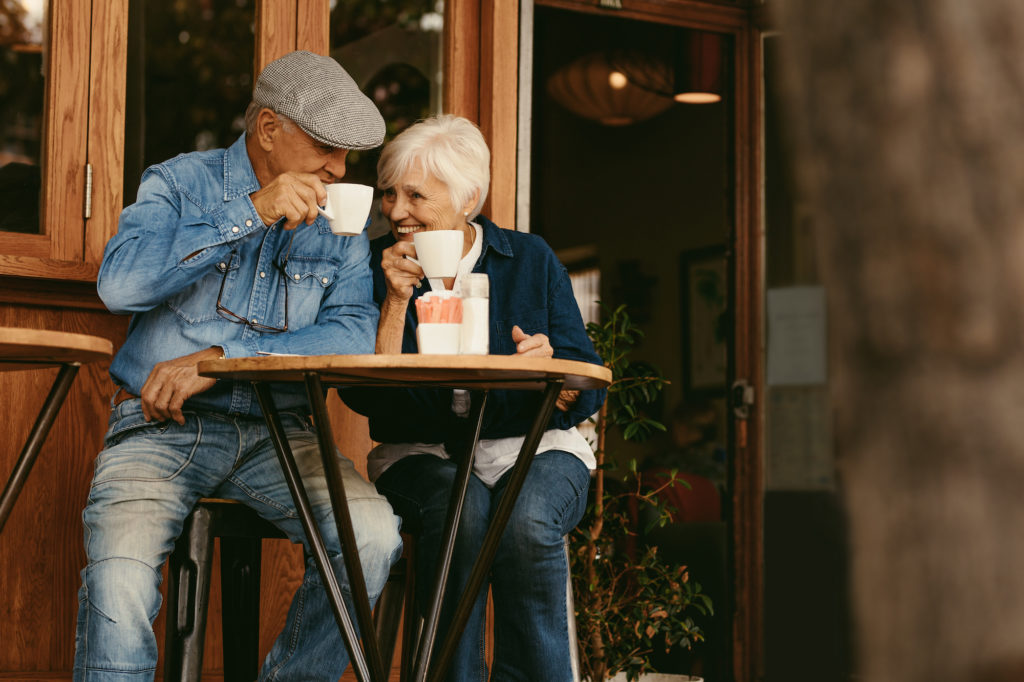 senior couple having a coffee date at a rustic cafe