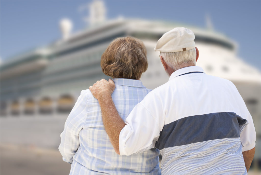 Senior couple looking at cruise ship while in the dock.