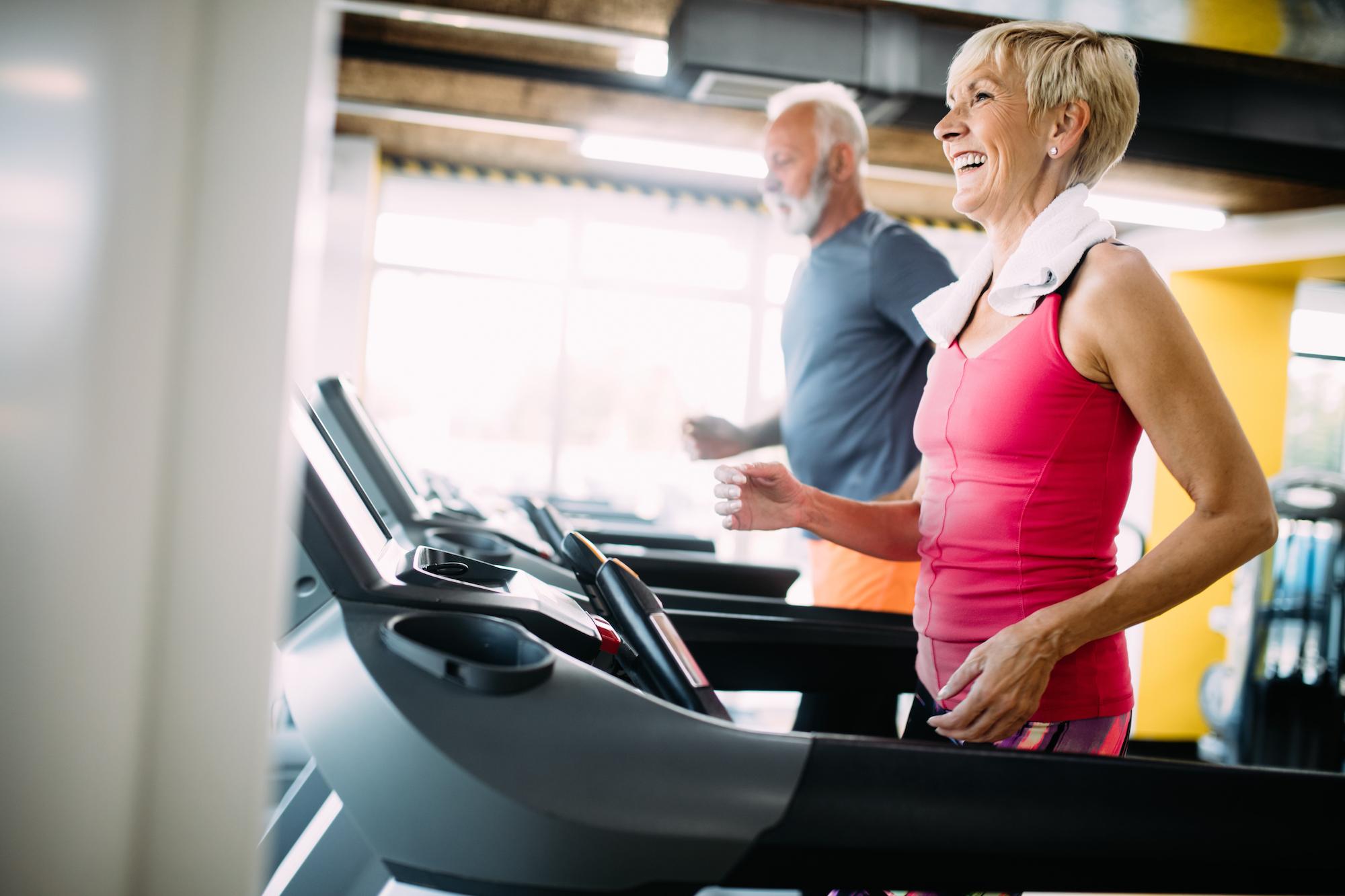 senior woman exercising on treadmill