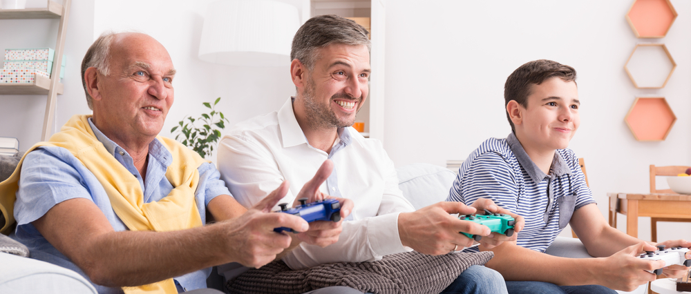 three generations of men playing video games together