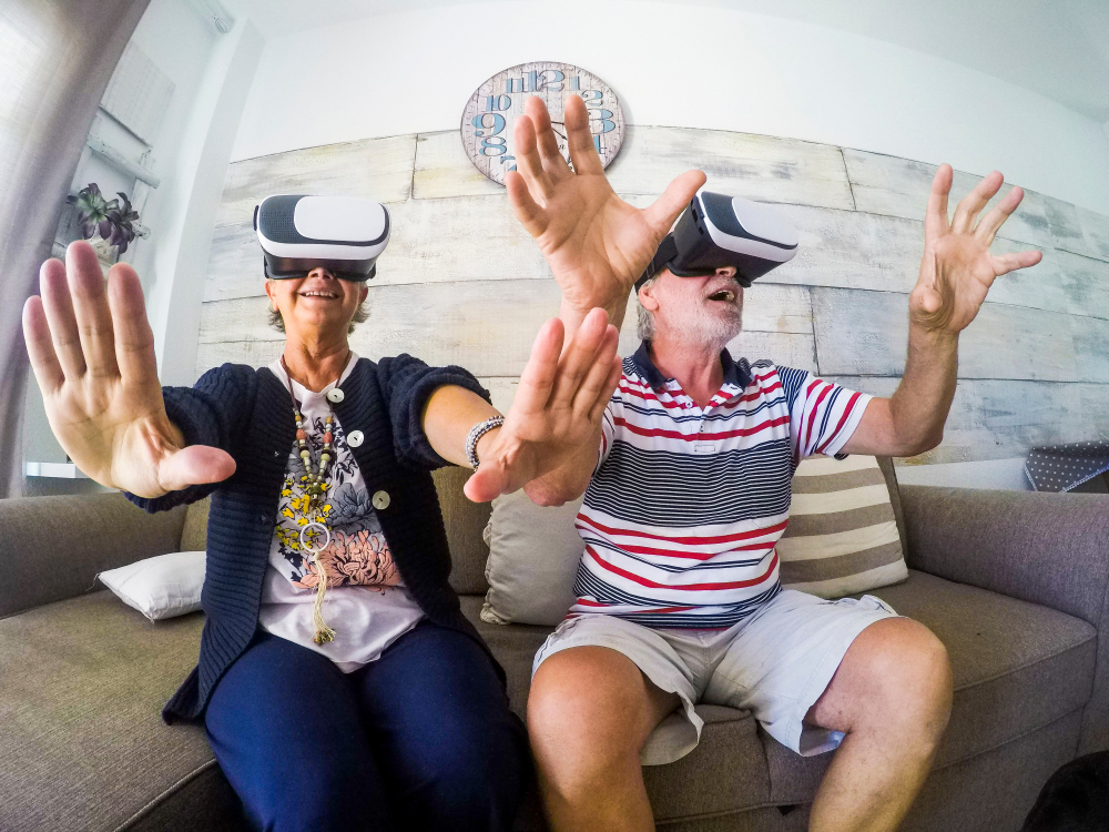 two seniors playing virtual reality games