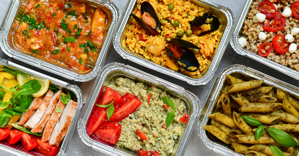 variety of healthy meals in oven-safe containers perfect for seniors and elderly people