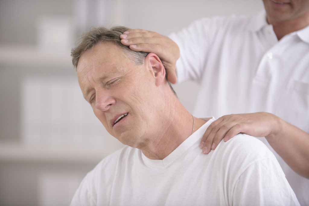A man visits a chiropractor for an adjustment.