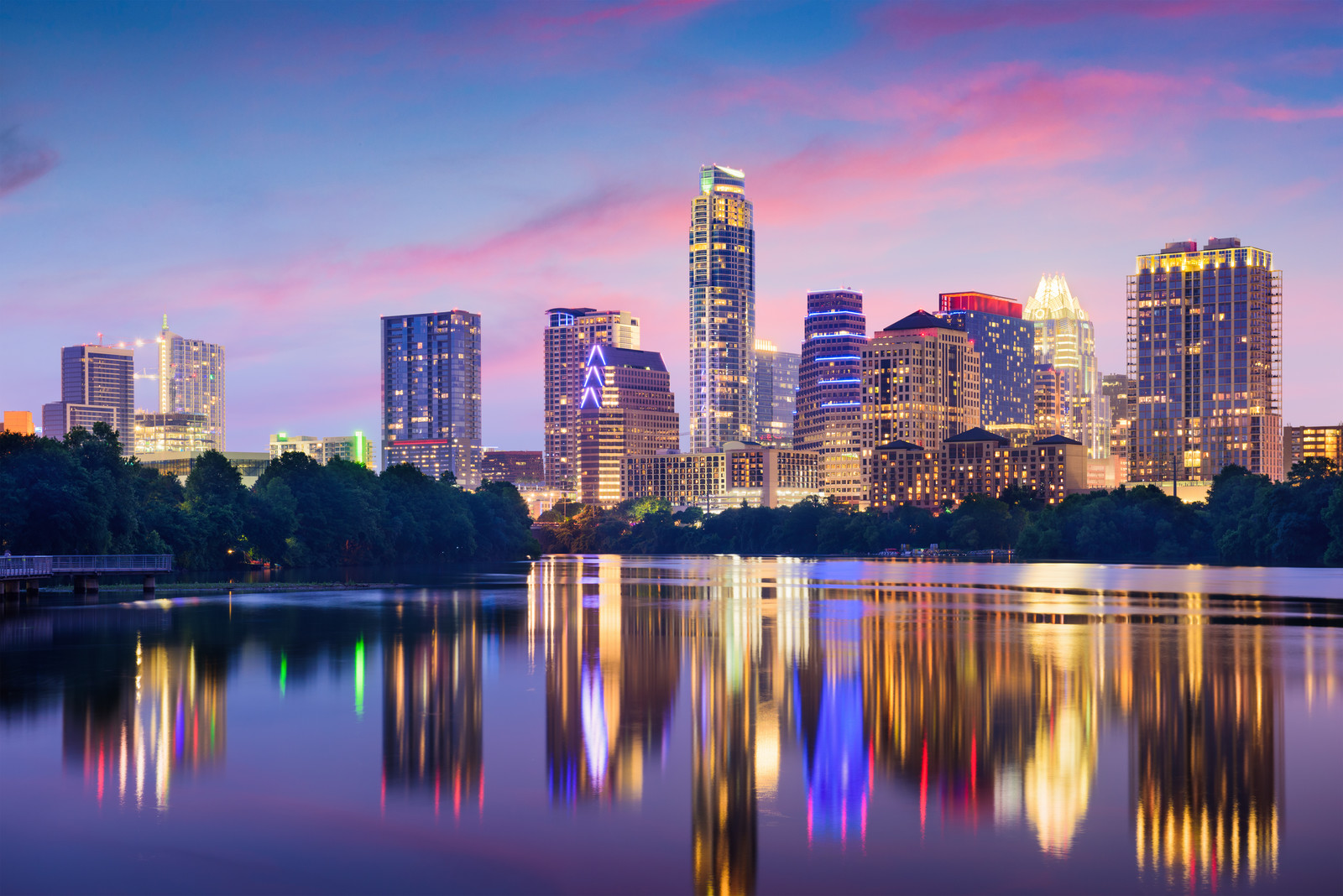 Evening skyline of Austin with the lights reflecting off the water