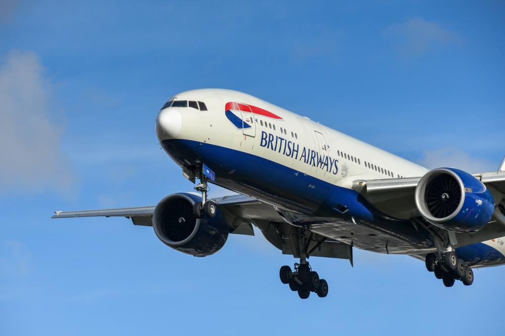 British Airways plane flying in a blue sky