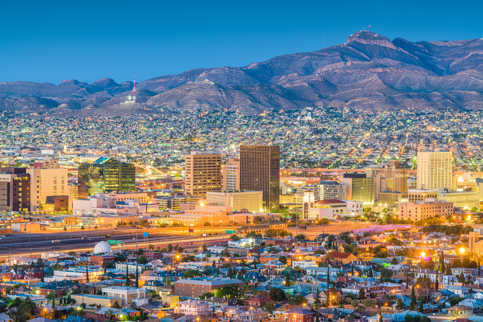El Paso at night with mountain back drop