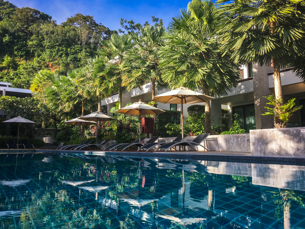 Hotel swimming pool in a lush tropical setting at Wyndham Sea Pearl Resort, Phuket