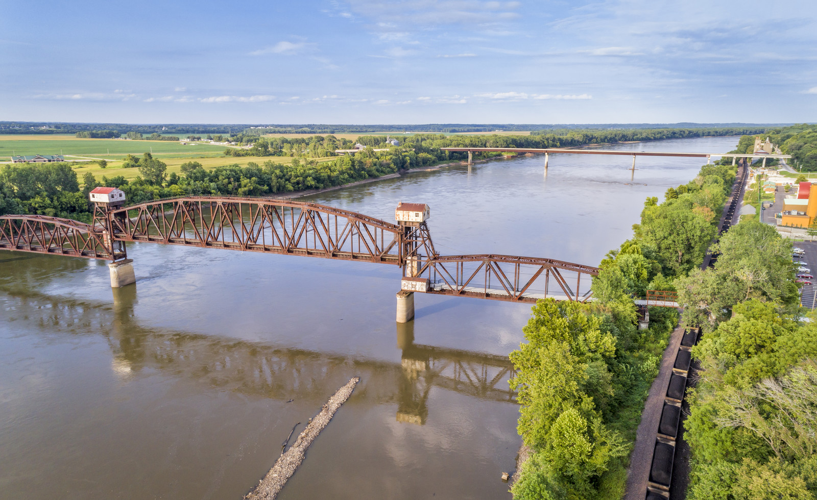Katy Texas Bridge over the Missouri River, with trees lining both banks