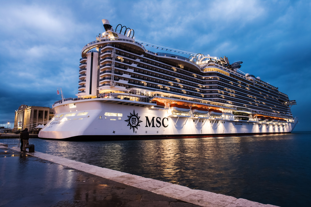 MSC Cruise Ship in dock in the evening with lights on
