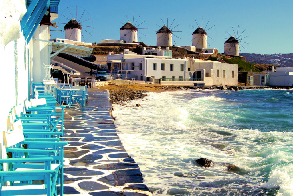 The port town of Mykonos with beach chairs and the ocean
