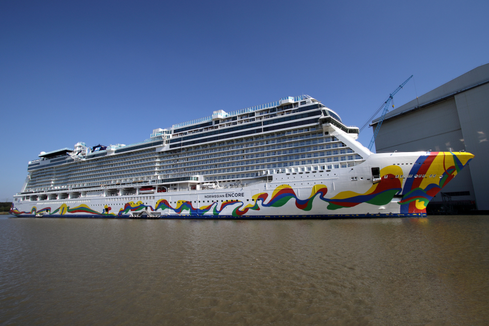 Brightly painted Norwegian Encore cruise ship in dock