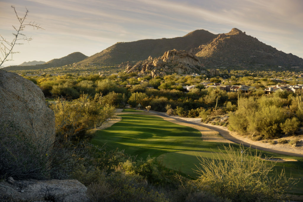 Scottsdale golf course green with hones and foothills in the background.