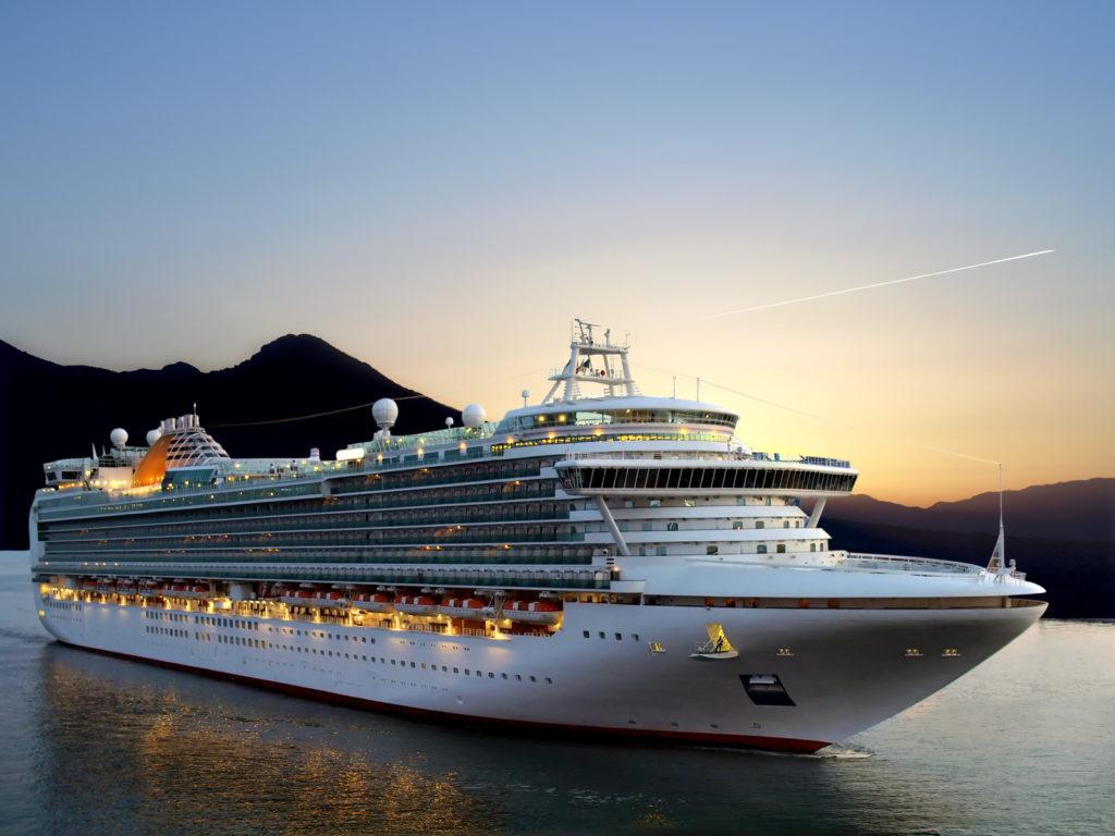 A beautiful cruise ship at sunset.