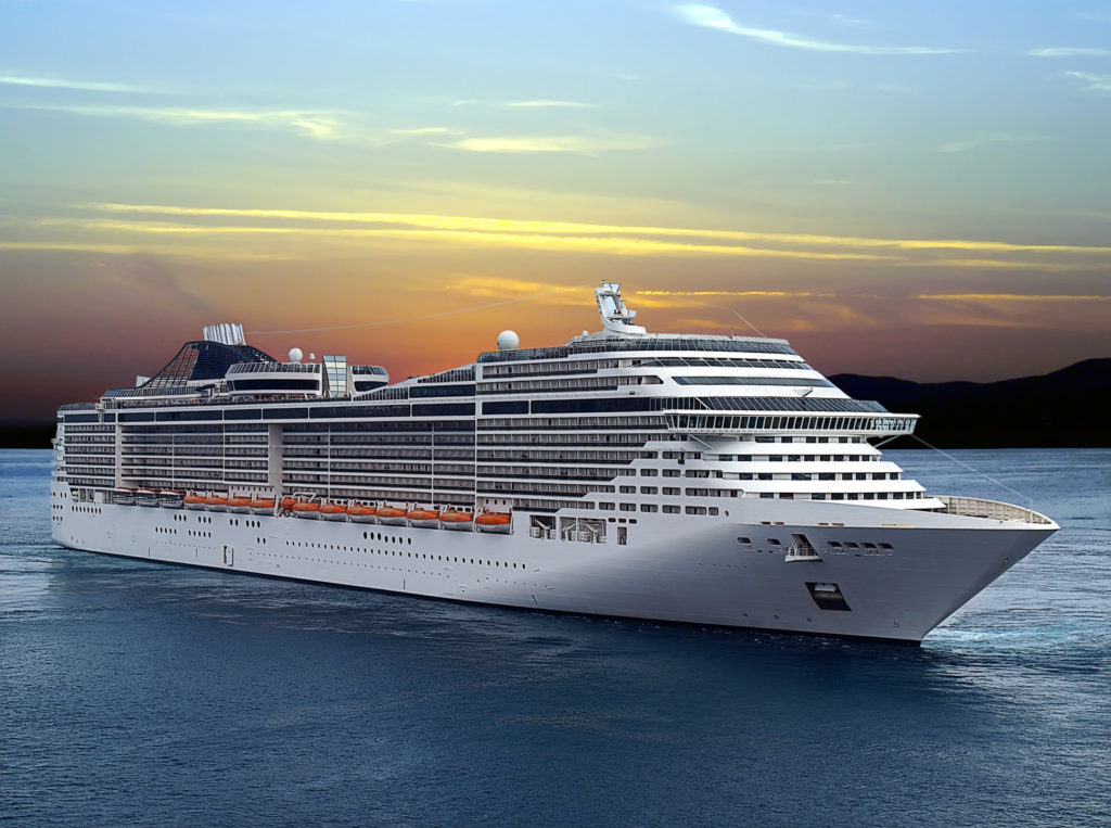 An accessible cruise for seniors glides across the water against the backdrop of a sunset.
