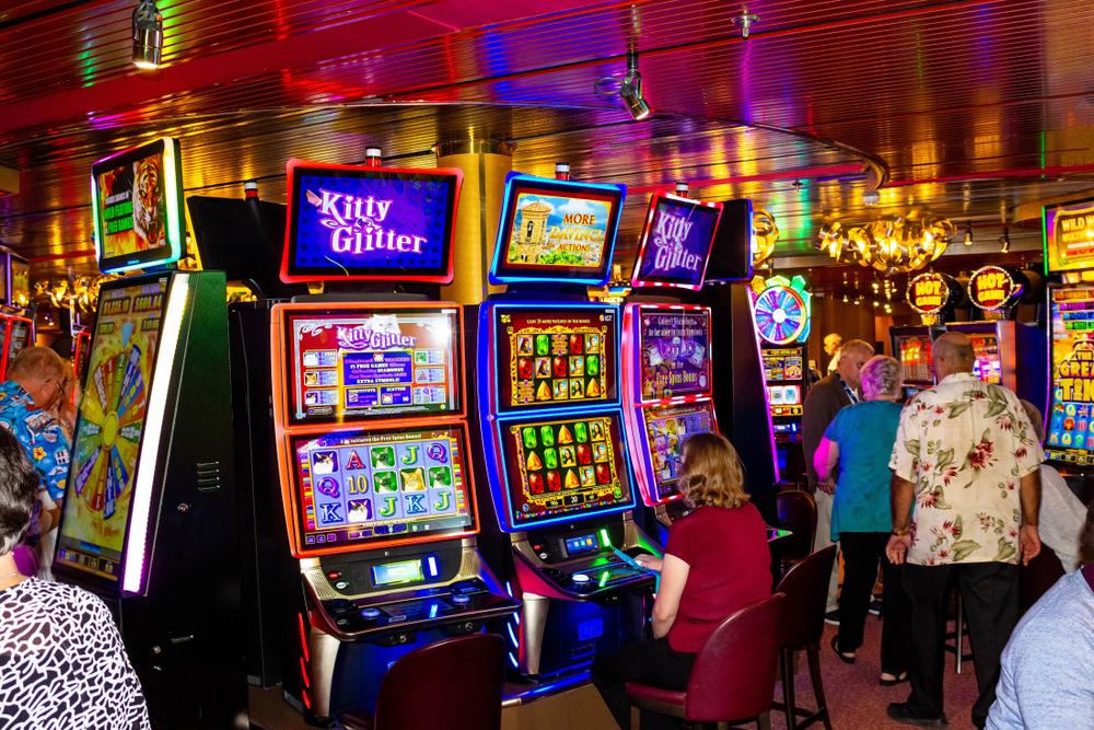 gambling on slot machines on Holland America cruise line in Half Moon Cay island, Bahamas