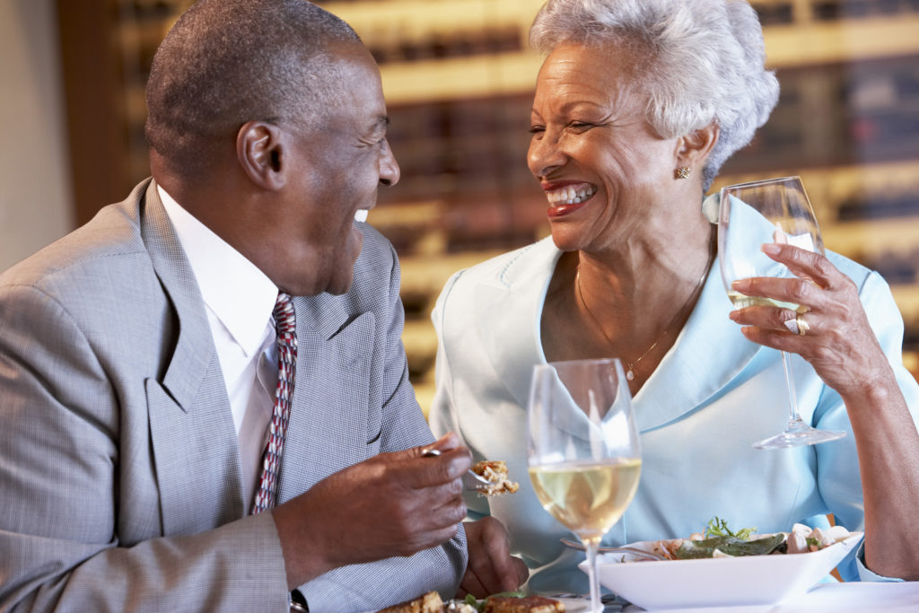 Senior couple dines at a fine dining restaurant.