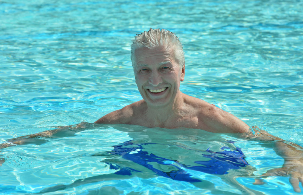 A senior man in a swimming pool.