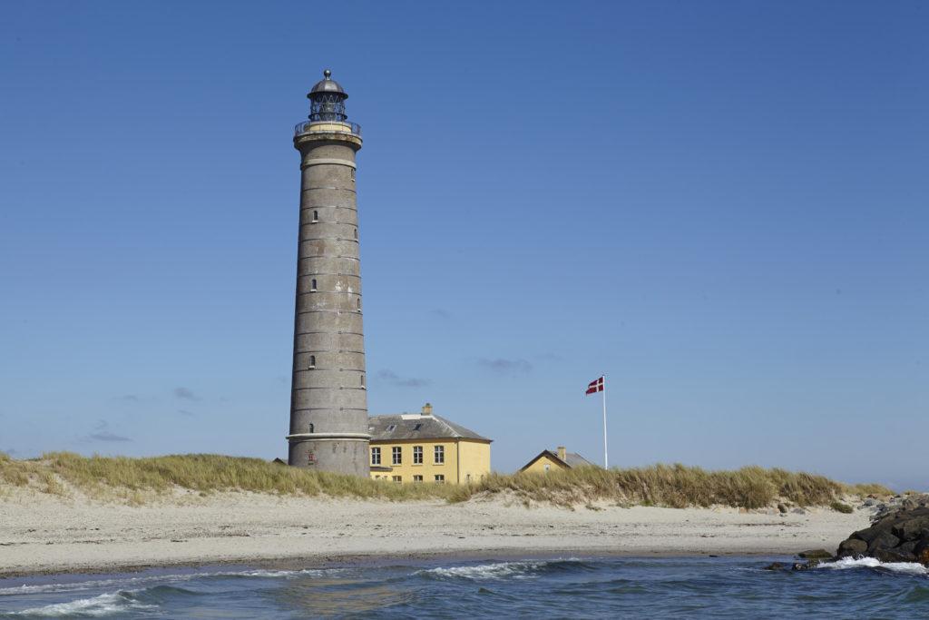 The beach in Denmark with a lighthouse.