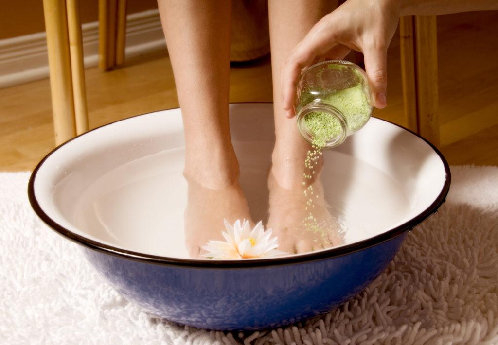 Woman soaking feet in a bowl.
