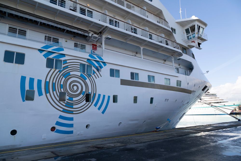 A Crystal Cruise ship with a logo on the side