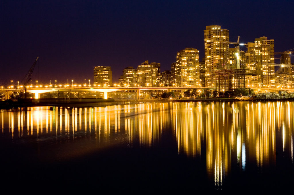 A beautiful Vancouver skyline at night on the water.