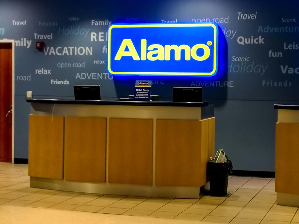 Alamo car rental desk at an airport