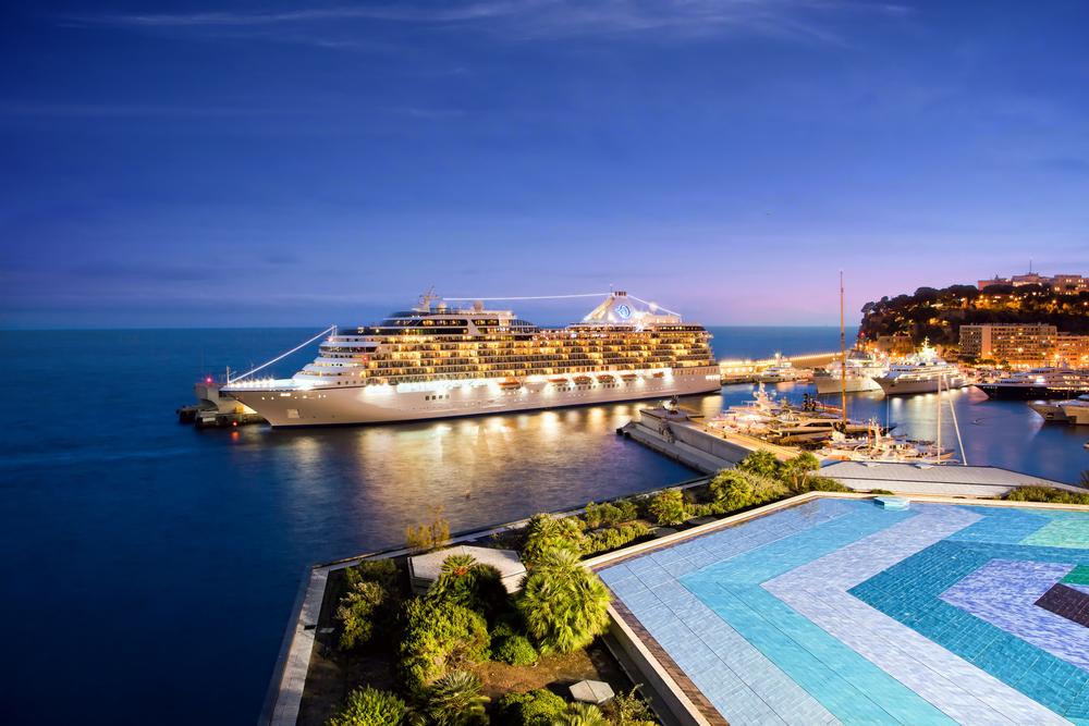 An Oceania cruise ship docked in Monte Carlo at night