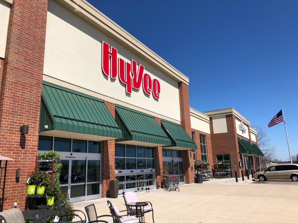 Exterior of a Hy-Vee store with cars parked out front