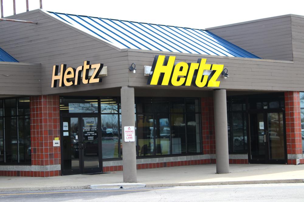 An exterior shot of a gray Hertz building