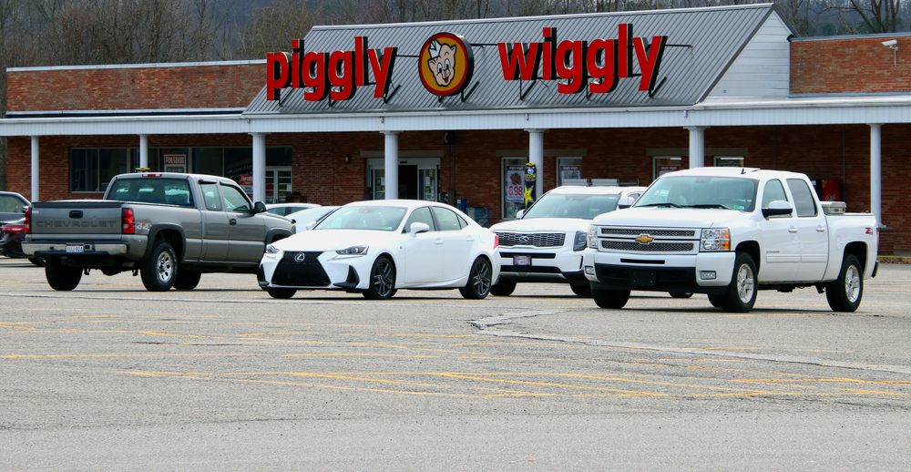 Outside of a Piggly Wiggly store with cars
