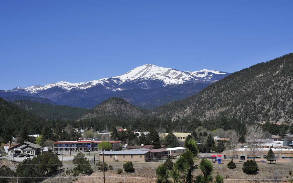 Ruidoso, New Mexico with mountains, trees and the town