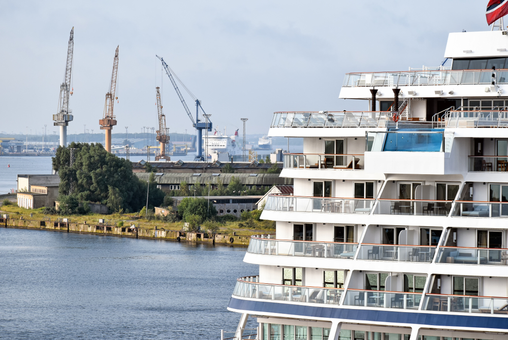 Staterooms on a Viking cruise ship with a harbor in the background