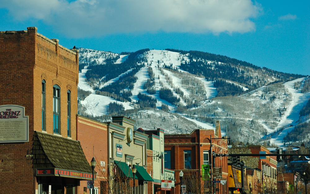 The town of Steamboat Srpings in Colorado with mountains in the background