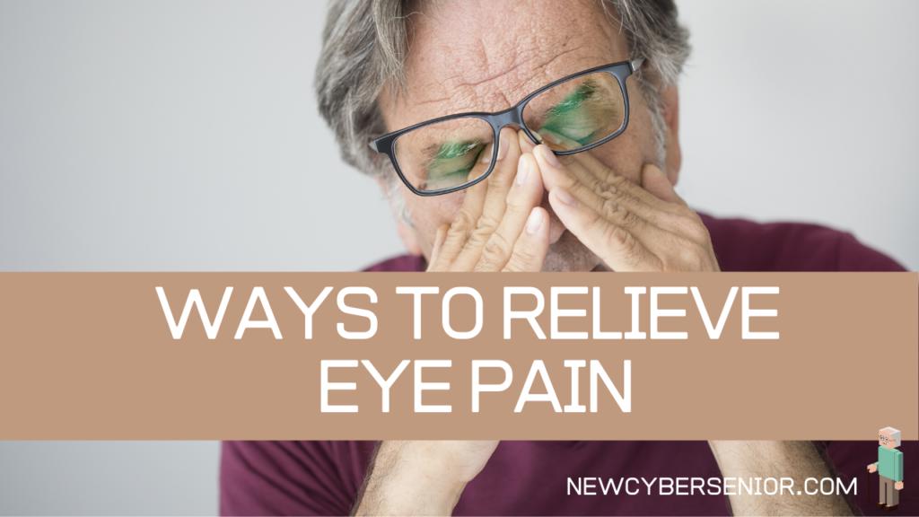 An older man rubbing his eyes