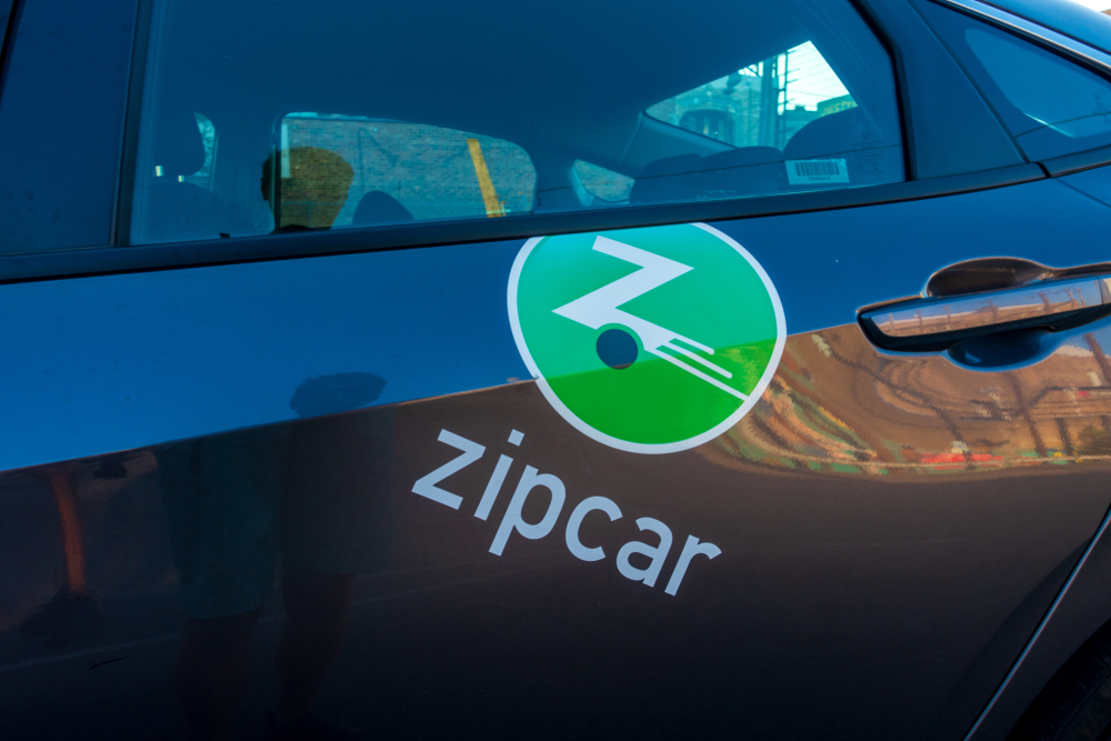 Zip Car Rental with the green logo