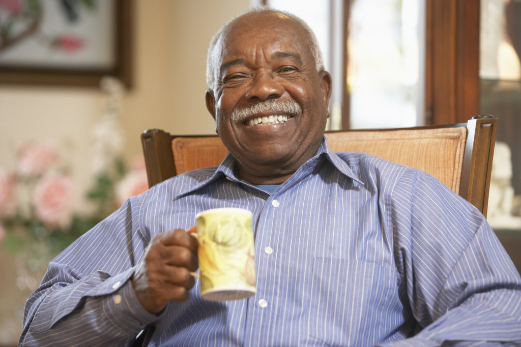 A senior man drinking a cup of coffee.