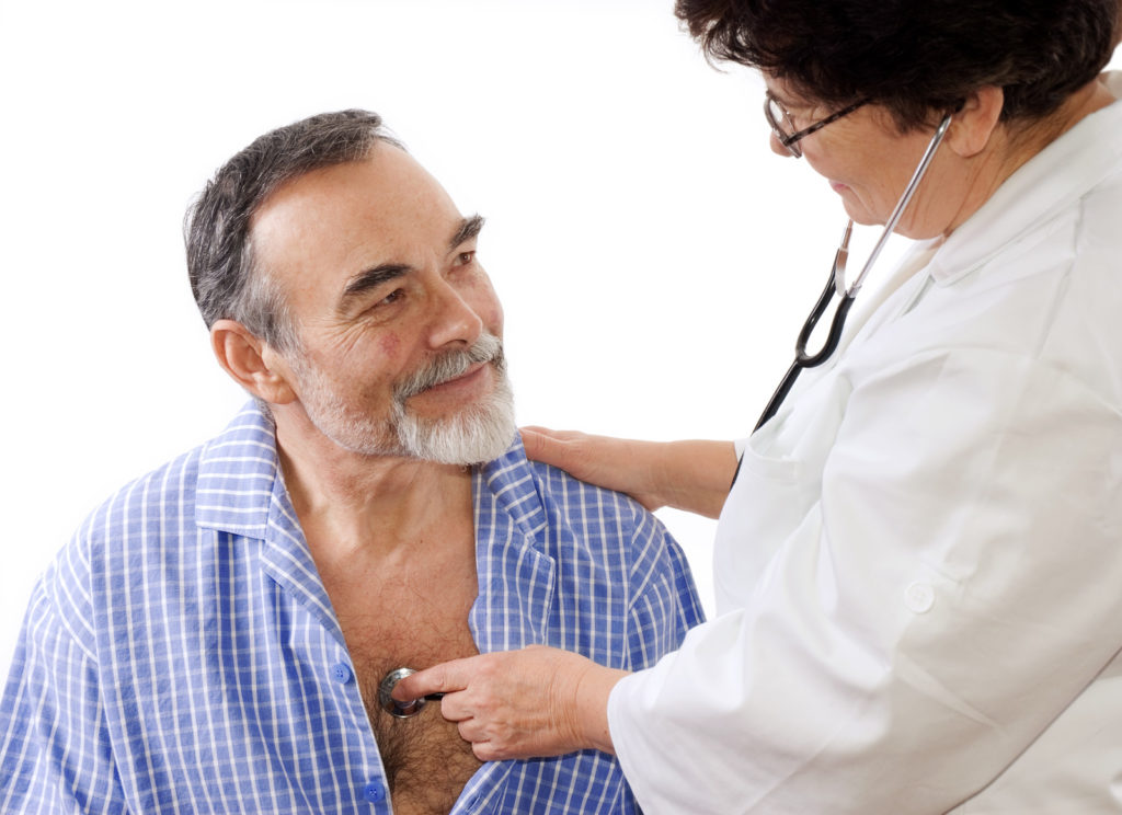 A senior man is getting checked out by a doctor.