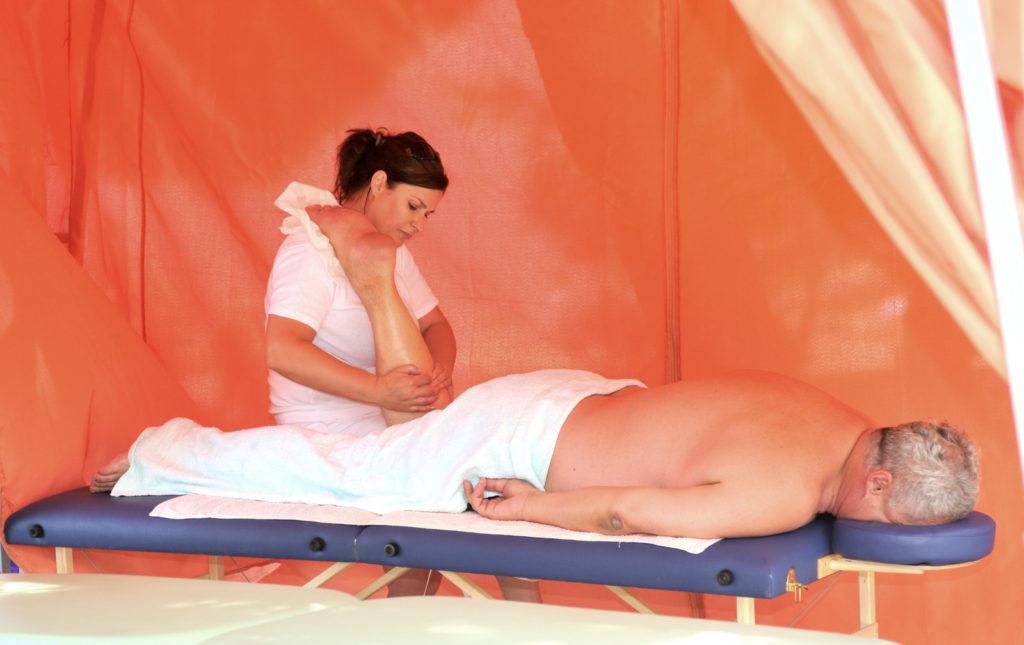 A senior man getting a massage.