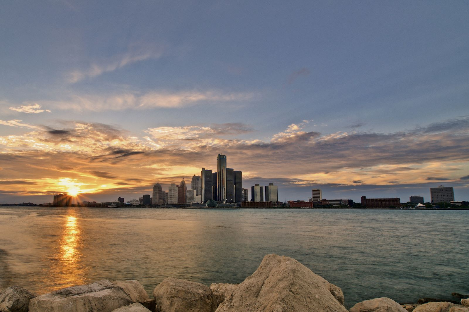 Top 5 Places To Retire in Michigan - Detroit skyline at sunset overlooking the detroit river