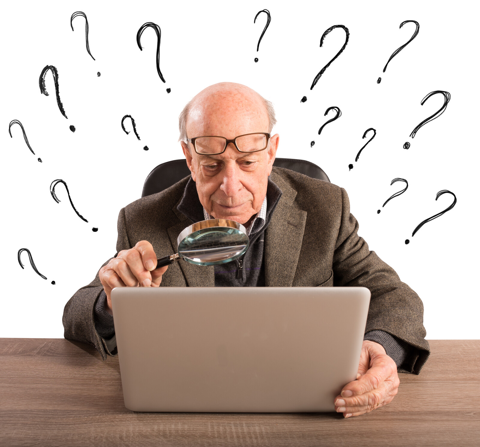 Senior man looking at a computer with a magnifying glass with question marks surrounding him