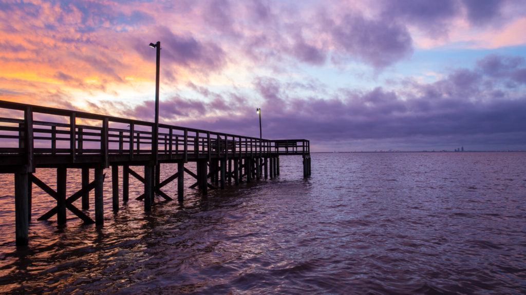 A pier at sunset in Fairhope Alabama